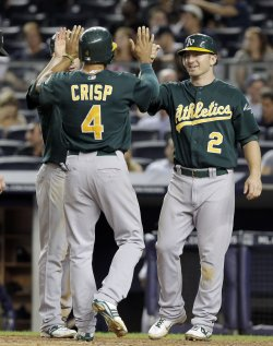 Oakland Athletics Coco Crisp and Cliff Pennington celebrate at Yankee Stadium in New York