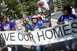 Housing Activists Protest Budget Cuts and Rent Increases at Trump Hotel