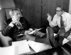RICHARD NIXON AND HENRY KISSINGER ABOARD AIR FORCE ONE