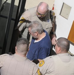 Former Police Sergeant Drew Peterson Arraigned on Murder Charge in Joliet, Illinois