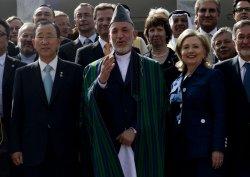 Afghan President Karzai walks with U.N. Secretary General Ban Ki-moon and US Secretary Clinton in Kabul