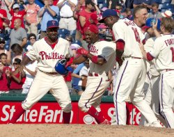 Philadelphia Phillies Jimmy Rollins wins the game with a RBI