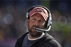 Head Coach Todd Haley and the Chiefs defeat the Raiders in Oakland, California