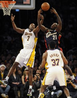 Los Angeles Lakers' Lamar Odom and the Cleveland Cavaliers' J.J. Hickson go for a rebound during the second half of an NBA basketball game in Los Angeles