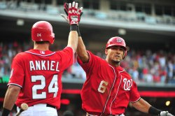 Naitonals' Ian Desmond connects for a solo homerun in Washington