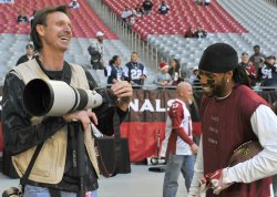 Larry Fitzgerald shares a laugh with Randy Johnson in Arizona