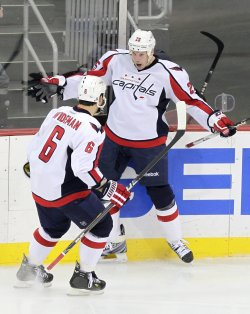 Washington Capitals Jason Chimera and Dennis Wideman celebrate a goal at the Prudential Center in New Jersey