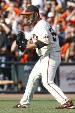 Giants Sergio Romo yells after striking out San Diego Padres Yorvit Torrealba in San Francisco