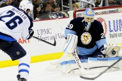 Penguins Fleury Makes Glove Save on Jets Wheeler in Pittsburgh