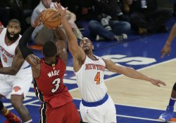 New York Knicks Arron Affalo leaps to defend Miami Heat Dwyane Wade