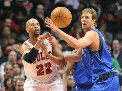 Bulls' Gibson passes around Mavericks' Nowitzki in Chicago