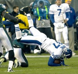 Indianapolis Reggie Wayne over the top of Eagles Patterson n the first quarter