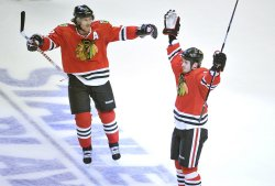 Blackhawks Keith and Bolland celebrate goal in Chicago