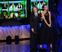 David Spade and Kaley Cuoco present an award at the 63rd annual Primetime Emmy Awards in Los Angeles