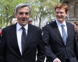 Liberal Democrat Chris Huhne and Danny Alexander leave meeting with Conservatives.