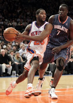 New York Knicks Toney Douglass drives to the basket by Charlotte Bobcats DeSagana Diop at Madison Square Garden in New York