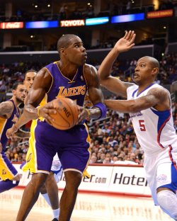 Los Angeles Lakers' Antawn Jamison drives by Los Angeles Clippers Caron Butler in Los Angeles