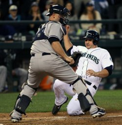 NEW YORK YANKEES PLAY THE SEATTLE MARINERS IN SEATTLE.