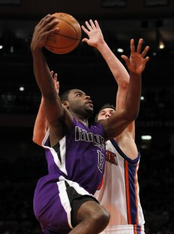 Sacramento Kings Tyreke Evans drives past New York Knicks Danilo Gallinari at Madison Square Garden