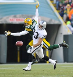 Raiders Branch breaks up pass intended for Packers Jennings in Green Bay, Wisconsin