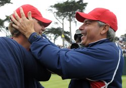 Fred Couples hugs Lucas Glover after the U.S. team won the 2009 Presidents Cup in San Francisco