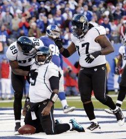 Jacksonville Jaguars Marcedes, David Garrard and Uche Nwaneri react at New Meadowlands Stadium in New Jersey