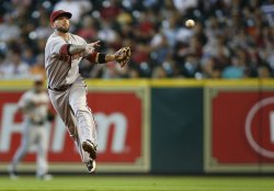 Arizona Diamondbacks Second Baseman Ryan Roberts Throws To First For An Out at Minute Maid Park in Houston