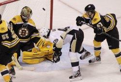 Penguins Asham scores against Bruins at TD Garden in Boston, MA.