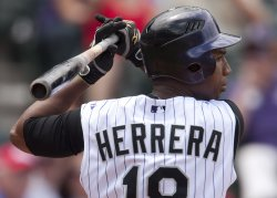 Rockies Herrera Waits on Pitch from Giants Cain in Denver