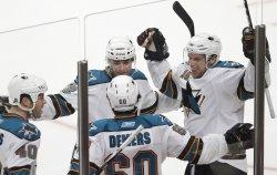 Sharks celebrate Demers' goal againsth Blackhawks in Chicago