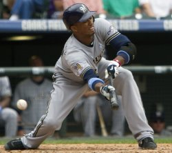 Brewers Shortstop Escobar Attempts Sacrifice in Denver