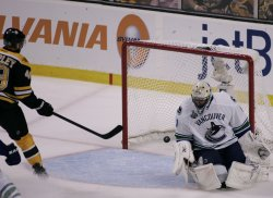 Bruins Peverley scores against Canucks Luongo in game 4 of the NHL Stanley Cup Finals in Boston, MA.