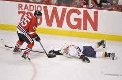 Blackhawks' Shaw and Predators' Suter go for Puck in Chicago