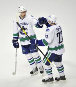 Canucks Edler and Hamhuis celebrate goal in Chicago