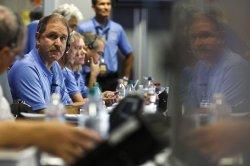 Jet Propulsion Laboratory team members celebrate Mars Rover's safe landing in Pasadena, California
