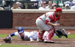 New York Mets Jason Bay slides into home at Citi Field in New York