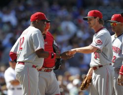 Reds Baker takes out Woods against Cubs in Chicago