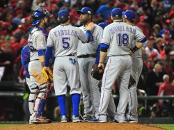 Texas Rangers talks to pitcher Darren Oliver during game 6 of the World Series in St. Louis