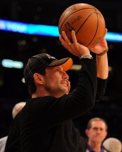 Christian Slater shoots the ball during Lakers game against the Boston Celtic's during NBA game in Los Angeles