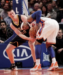 New York Knicks Carmelo Anthony and Indiana Pacers Tyler Hansbrough fight for a loose ball at Madison Square Garden in New York