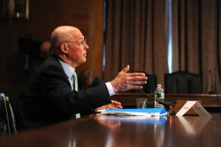 Former Treasury Secretary Henry Paulson testifies on investment banking in Washington