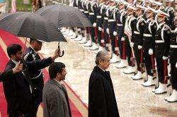 Iran's President Mahmoud Ahmadinejad meets Malaysian Prime Minister Abdullah Ahmad Badawi in Tehran