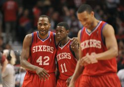 76ers' Brand hugs Holiday during Playoff in Chicago