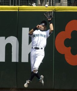 Seattle Mariners' right fielder Ichiro Suzuki leaps to catch a pop fly hit by Los Angeles Angels Kendry Morales.