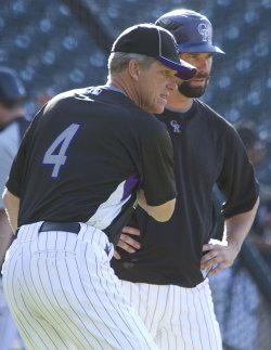 Rockies Manager Tracy Gives Batting Tips to Helton in Denver