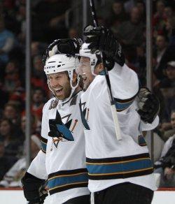 Sharks' Thornton and Heatley celebrate goal against Blackhawks in Chicago
