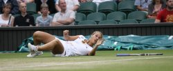 Dominika Cibulkova falls over at Wimbledon.