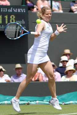 Kim Clijsters returns the ball on the third day of Wimbledon.
