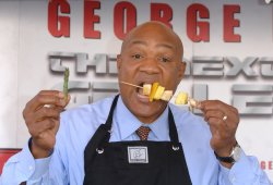GEORGE FOREMAN DEMONSTRATES HIS GRILLING MACHINE