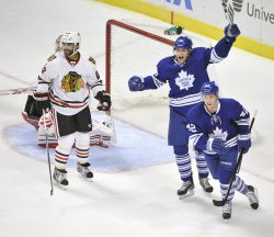 Maple Leaf's Lupul and Bozak Celebrate Goal Against Blackhawks in Chicago